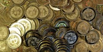 Bitcoin Drops below $1,000 amid Heightened Pressure