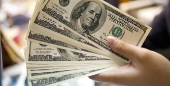 Dollar Flat After Postponement of Health Care Vote