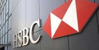 HSBC mencatatkan kenaikan laba yang tidak terduga saat bank membatasi penurunan pendapatan