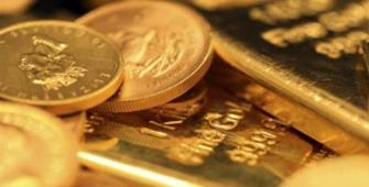美元稳定,金价收低