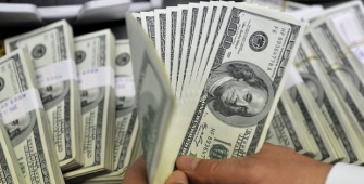 Dollar Steady as Investors Await Fed Statement
