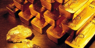 Gold Falls to 3-Week Low, Weighed Down by Fed Outlook