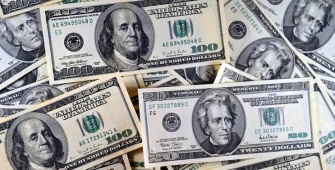 Dollar Climbs after Fed Signals Rate Hike in December