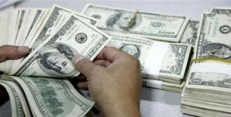 Dollar Marginally Declines as Markets Await U.S. Inflation Data