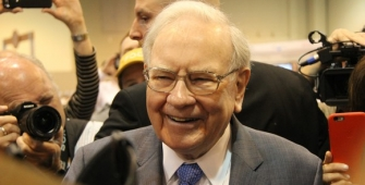 Buffet Boosts Stake in Apple, Slashes Bet in IBM