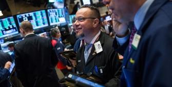 Wall Street Gains as Dow Jumps, Nasdaq Hits Record Close