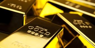 Precios del oro suben mientras el dólar sigue bajo presión
