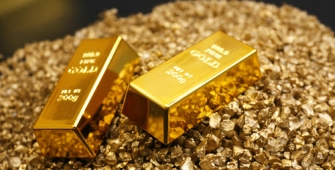 Gold Prices Flat as Dollar Holds Firms