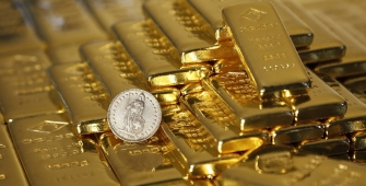Gold Prices Rise to 1-Week Peak as Dollar Steady