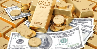 Gold Prices Rise as Dollar Drops on Tax Bill Jitters