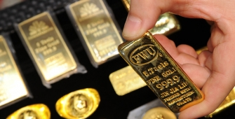 Gold Prices Slightly Lower as Dollar Firms on US Tax Bill...
