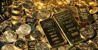 Золото держится у максимума четырех месяцев