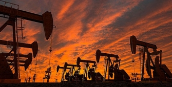 Oil Prices Slide on U.S. Production Recovery