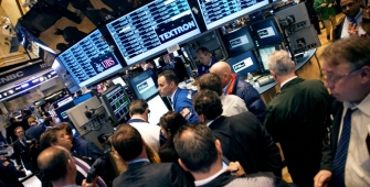 Nasdaq, S&P End at Record Peaks; Dow Weighed Down by...