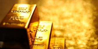 Gold Prices Drop, Weighed Down by U.S. Rate Hike Expectations, Easing Global Tensions