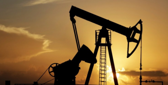 Oil Prices Drop as Russia Warns of Gradual Output Rise