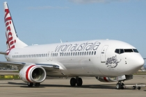 Virgin Australia first-half profits drop, defers Boeing deliveries