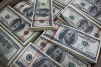 Dollar Held on to Gains as Risk Sentiment Grows