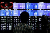 Asian Markets Flat as Dollar Climbs