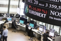 European Markets Drop as Commodities Decline, Earnings Mixed