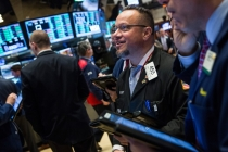 Wall Street Gains as Dow Jumps, Nasdaq Hits Record Close