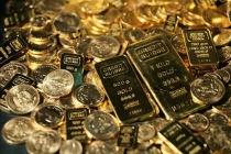 Золото торгуется разнонаправленно на фоне опасений инвесторов за будущее налоговой реформы
