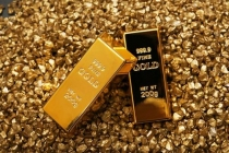 Gold Prices Notch 1-Week Low on Firm Dollar; Fed Minutes in Focus