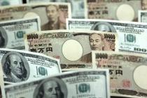 Доллар дорожает к иене и евро