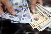 Доллар снижается на фоне торговых войн и геополитических трений