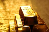 Золото падает в цене на фоне снижения геополитических рисков