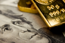 Gold Prices Drop, Weighed Down by Stronger Dollar